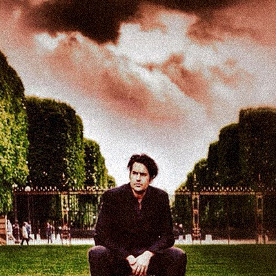 "The ""eternal wanderer,"" Roman Payne, beneath the Parisian sky at the Jardin du Luxembourg (2014) 